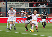 August 5th 2017, Dens Park, Dundee, Scotland; Scottish Premiership; Dundee versus Ross County; Ross County's Andrew Davies tackles Dundee's Sofien Moussa