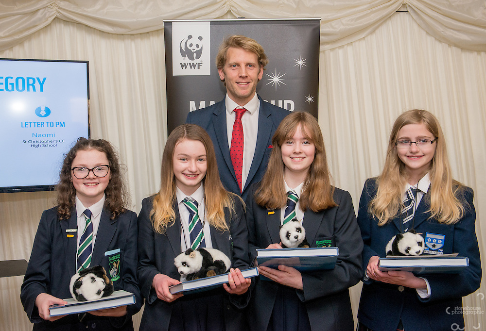 Andrew Triggs Hodge OBE presenting School Awards Secondary category winners Naomi (Letter to PM), Evie(Poem) Olivia and Rhiannon (Poster) during the WWF UK Earth Hour 10th Anniversary Parliamentary Reception, Terrace Pavilion, Palace of Westminster. 28th Feb. 2017