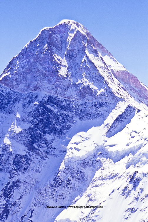 The sacred mountain Khan-Tengri stands along Kazakhstan's border with Kyrgyzstan and China.  At 6,995 meters (about 23,000 feet), it is only a few thousand feet lower than Mount Everest.  This image was made through the open window of a Kazakh Air Force high-altitude helicopter flying at 6,700 meters (about 22,000 feet).