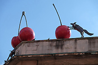 "Urban outdoor sculpture ""Foxes and Cherries"" by Lucy Casson on rooftop in Brixton South London"