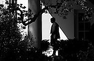 U.S. President George W. Bush walks outside the Oval Office in Washington.
