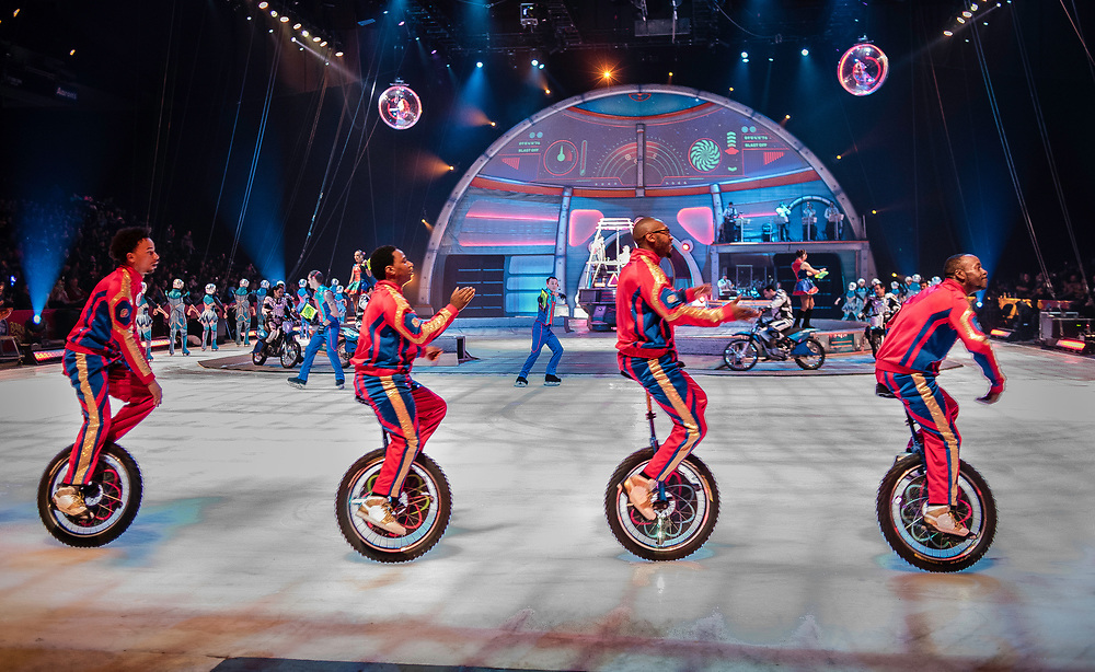 BALTIMORE, MD -- 4/21/17 -- Members of the King Charles Troupe warm up the crowd during the pre-show. The King Charles Troupe is the first African-American circus act in Ringling Bros. history, having debuted in 1969. The unicycle act plays basketball and even performs on ice during the show. Ringling Bros, the self-proclaimed Greatest Show on Earth, is in the final leg of a 146 year run. The final performances will be held in May. Out of This World, one of two circus units, recently had performances in Baltimore, led by Jonathan Lee Iverson, the first African-American ringmaster in the show's history…by André Chung #_AC14652