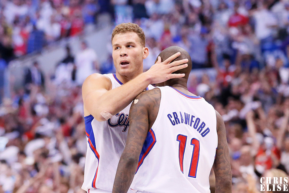 11 May 2014: Los Angeles Clippers guard Jamal Crawford (11) is congratulated by Los Angeles Clippers forward Blake Griffin (32) during the Los Angeles Clippers 101-99 victory over the Oklahoma City Thunder, during Game Four of the Western Conference Semifinals of the NBA Playoffs, at the Staples Center, Los Angeles, California, USA.