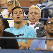 Boris Becker, (centre), watching Serena Williams, USA, in action against Carla Suarez Navarro, Spain, during the Women's Singles competition at the US Open. Flushing. New York, USA. 2nd September 2013. Photo Tim Clayton