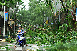 Oct. 18, 2016 - Qionghai, China - Branches are broken in typhoon-hit Qionghai City, south China's Hainan Province. Typhoon Sarika, the 21st typhoon of the year, made landfall at Hainan Province Tuesday morning. The tropical cyclone, packing maximum winds of 162 km per hour, landed at Hele Town, Wanning City, at 9:50 a.m., according to local meteorological bureau.  (Credit Image: © Meng Zhongde/Xinhua via ZUMA Wire)
