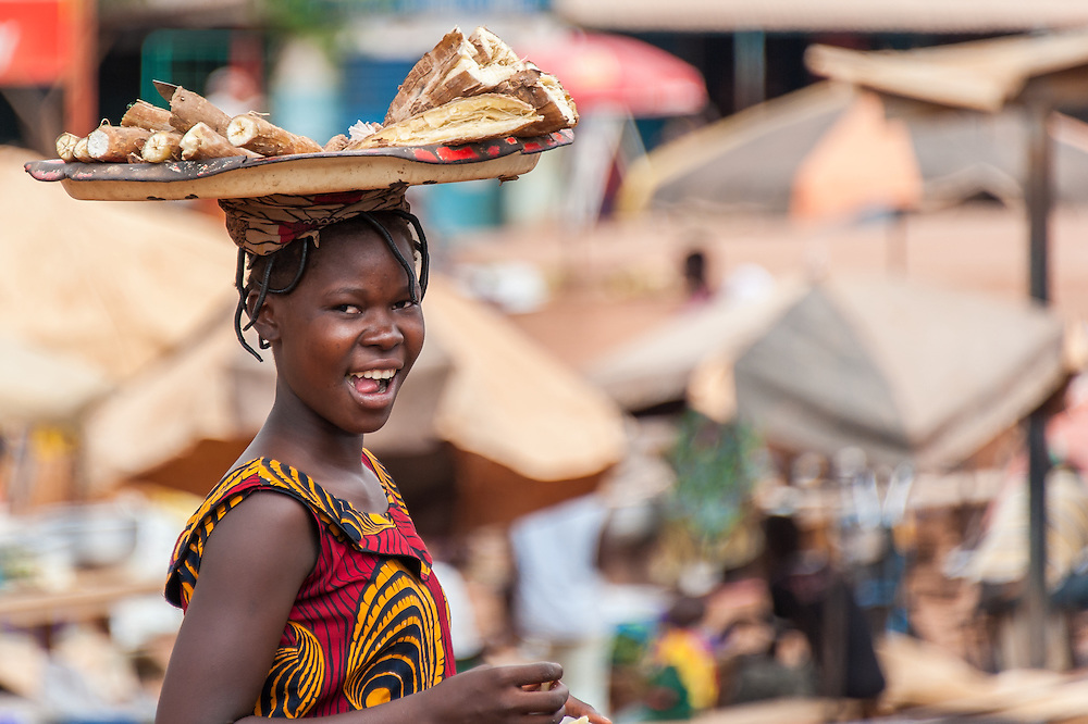 Portrait of a young Burkinabe girl selling sweet potatoes in a local farmer's market in central Burkina Faso