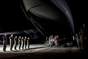 The honor guard carries the remains including those from the Battle of Buna, which took place in Papua New Guinea in November 1942, off of C-17 on Wednesday, March 8, 2017 at Offutt Air Force Base in Nebraska. Remains linked to the battle will be identified using DNA technology at Offutt Air Force Base.