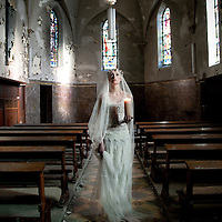 woman with candle in a abandoned church