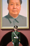 Soldier stands infront of Chairman Mao's portrait at Gate of Heavenly Peace, Entrance to the Forbidden City, China