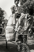 Cycle rickshaw driver and his passanger with large packages in Varanasi (Benares), India