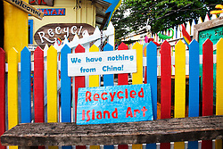 Sign outside The Rusty Fish, a souvenir shop selling craft items made from island scrap.