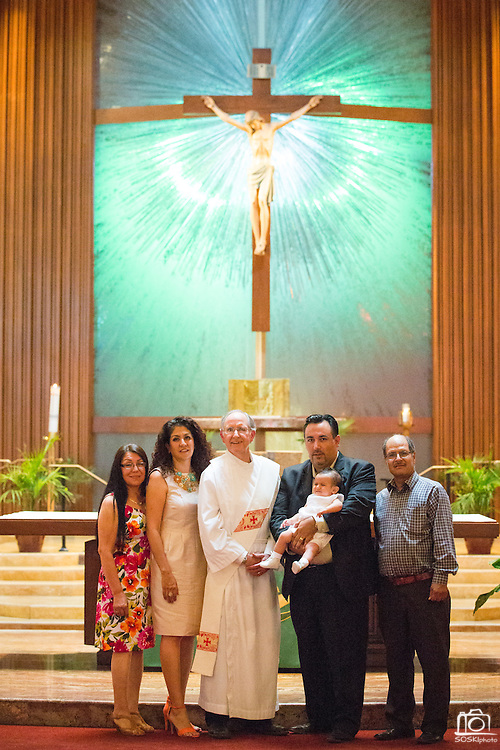 Family and friends celebrate the Baptism of Diego Marcelino at St. John the Baptist Church in Napa, California, on September 13, 2014. (Stan Olszewski/SOSKIphoto)