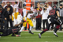 SANTA CLARA, CA - DECEMBER 05:  Running back Justin Davis #22 of the USC Trojans breaks a tackle from cornerback Terrence Alexander #11 of the Stanford Cardinal during the third quarter of the Pac-12 Championship game at Levi's Stadium on December 5, 2015 in Santa Clara, California. The Stanford Cardinal defeated the USC Trojans 41-22. (Photo by Jason O. Watson/Getty Images) *** Local Caption *** Justin Davis; Terrence Alexander