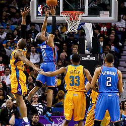 December 10, 2010; New Orleans, LA, USA; Oklahoma City Thunder guard Russell Westbrook (0) shoots over New Orleans Hornets small forward Trevor Ariza (1) during the second half at the New Orleans Arena.  The Thunder defeated the Hornets 97-92. Mandatory Credit: Derick E. Hingle-US PRESSWIRE
