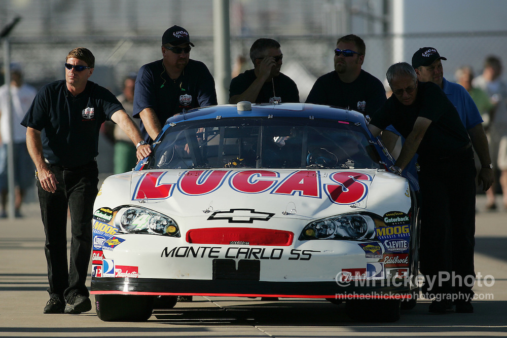 Scott Wimmer's crew pushes his car to inspection before qualifications for the Allstate 400 at the Brickyard Aug 5, 2006.