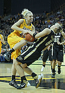 January 28, 2012: Iowa Hawkeyes guard Jaime Printy (24) is called for a charge as she drives on Purdue Boilermakers guard Brittany Rayburn (5) during the NCAA women's basketball game between the Purdue Boilermakers and the Iowa Hawkeyes at Carver-Hawkeye Arena in Iowa City, Iowa on Saturday, January 28, 2012.