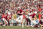 COLLEGE FOOTBALL: Stanford v Cal in the Big Game, Nov 22, 1975 at Stanford Stadium in Palo Alto, California.  Guy Benjamin #7 attempts a pass  Photograph by David Madison www.davidmadison.com.