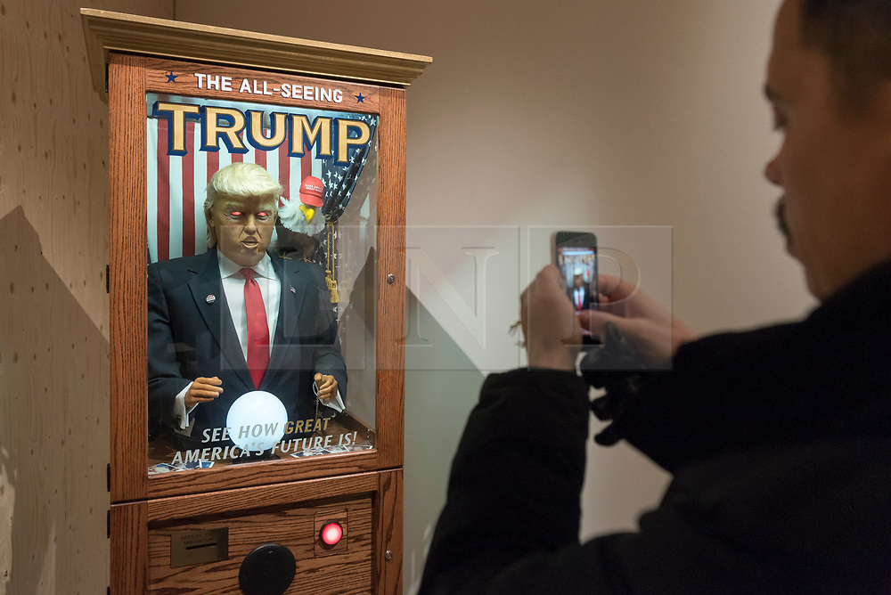 """© Licensed to London News Pictures. 27/03/2018. LONDON, UK. """"All Seeing Trump Machine"""", US, 2016, launched a month before the 2017 US Presidential election, this 'misfortune' gave voters a taste of Trump as President.  Preview of """"Hope to Nope: Graphics and Politics 2008-18"""", an exhibition examining the political graphic design of a turbulent decade encompassing the 2008 financial crash, Barack Obam presidency, Brexit and Donald Trump's presidency.  The exhibition takes place at the Design Museum 28 March to 12 August 2018.  Photo credit: Stephen Chung/LNP"""