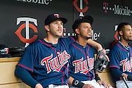 Trevor Plouffe #24 and Eduardo Escobar #5 of the Minnesota Twins watch the pre-game video while sitting in the dugout before a game against the Boston Red Sox on May 17, 2013 at Target Field in Minneapolis, Minnesota.  The Red Sox defeated the Twins 3 to 2.  Photo: Ben Krause
