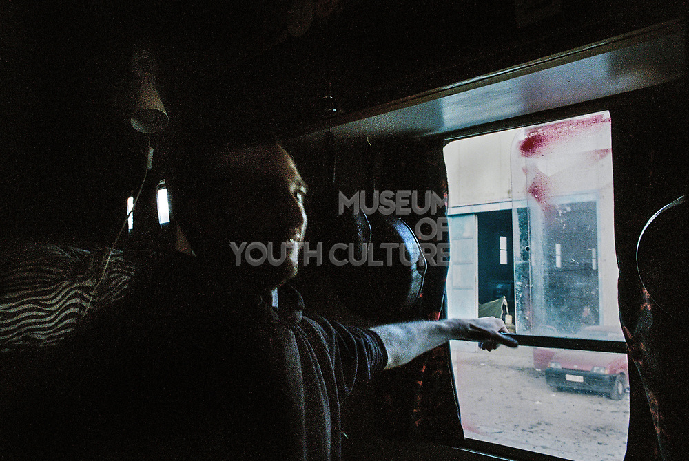 Man sits inside van at Napoli NYE Tek, a New Year's Eve party in Naples, Italy, December 2014