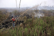 INDONESIA, Padamaran : 27 October 2015 Indonesian fire fighters extinguish the fire on peatland and fields at Ogan Komering Ilir district, South Sumatra. The air pollution or haze has been an annual problem for the past 18 years in Indonesia . forest fire in Sumatra and borneo that have caused widespread and haze in Southeast Asia. Pic by Hairul Akbar / Story Picture Agency