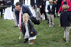 WASHINGTON, DC - APRIL 02: (AFP OUT) Donald Trump Jr. helps his daughter roll an egg during the 140th annual Easter Egg Roll on the South Lawn of the White House April 2, 2018 in Washington, DC. The White House said they are expecting 30,000 children and adults to participate in the annual tradition of rolling colored eggs down the White House lawn that was started by President Rutherford B. Hayes in 1878. (Photo by Chip Somodevilla/Getty Images)