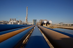 Stock photo of piping and storage tanks at a chemical plant