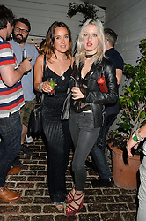 Left to right, JESS MILLS and HARRIET VERNEY at the Warner Music Group & GQ Summer Party held at Shoreditch House, Ebor Street, London on 17th July 2014.