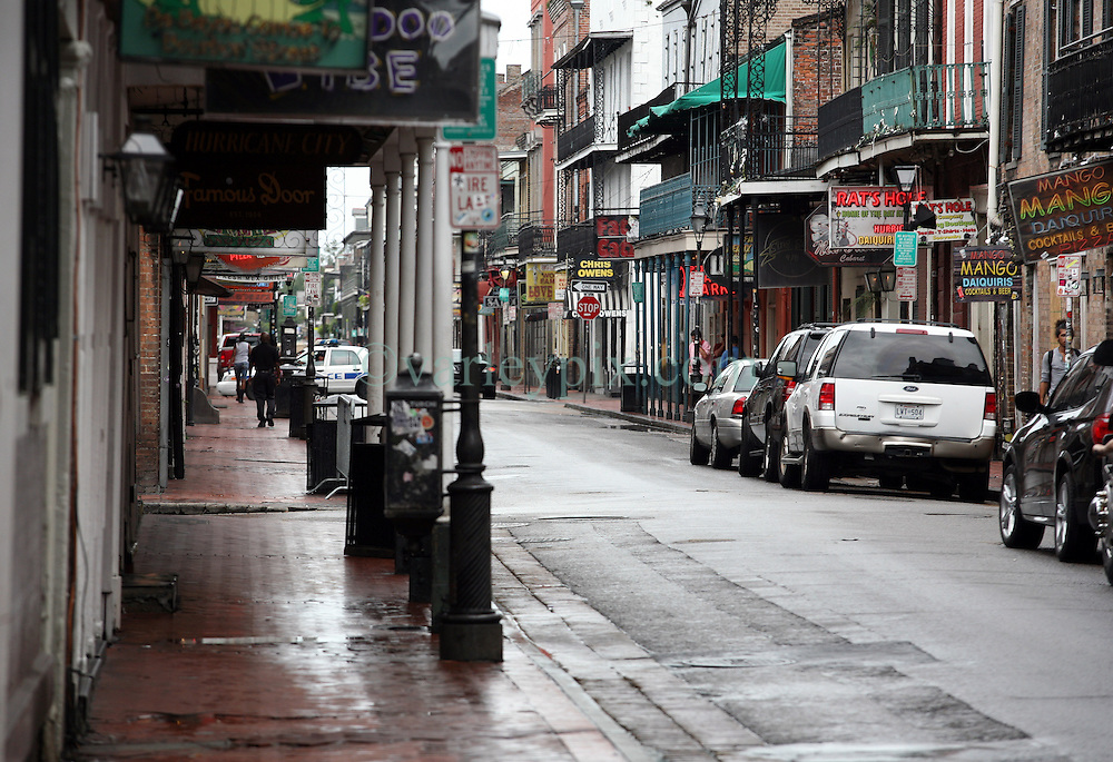 28 August 2012. New Orleans, Louisiana,  USA. <br /> An almost deserted Bourbon Street in the French Quarter. The 7th year anniversary of Hurricane Katrina is tomorrow and with a storm lurking in the Gulf many have evacuated as an uneasy calm settles over New Orleans.<br /> Photo; Charlie Varley