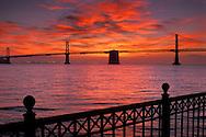 Suspension span of the Bay Bridge at sunrise, from Rincon Park on the Embarcadero, San Francisco, California