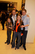 Nick and Ari Ashley with their children, Edie ( shorter)  and Lily. H&M Flagship Store launch. at 17-21 Brompton Road, Knightsbridge. London. SW1. 23  March 2005. ONE TIME USE ONLY - DO NOT ARCHIVE  © Copyright Photograph by Dafydd Jones 66 Stockwell Park Rd. London SW9 0DA Tel 020 7733 0108 www.dafjones.com