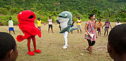 RARE Conservation Fellow Wida Sulistyaningrum and RARE mascots Red Snapper and Bryde's Whale lead student activities in Lobo Village, Triton Bay.