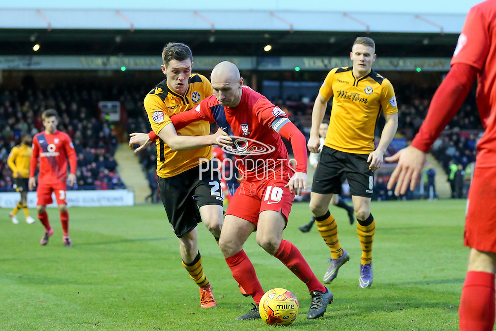 York City midfielder Russell Penn  and Newport County midfielder, on loan from Crystal Palace, Connor Dymond battle for the ball during the Sky Bet League 2 match between York City and Newport County at Bootham Crescent, York, England on 16 January 2016. Photo by Simon Davies.