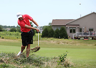 Kyle Peterman of Chatham, Illinois drives the ball out of a rough area on the 6th hole in first round of the Greater Cedar Rapids Open held at Hunters Ridge Golf Course in Marion on Friday, July 22, 2011.
