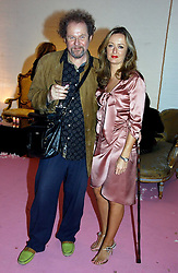 MIKE FIGGIS and LUCY YEOMANS at a dinner hosted by Harpers Bazaar to celebrate the launch of the fragrance Flowerbomb by Viktor & Rolf held at Elms lester, Flitcroft Street, London WC2 on 31st May 2006.<br /><br />NON EXCLUSIVE - WORLD RIGHTS