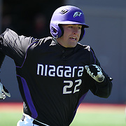 Joel Klock #22 of the Niagara Purple Eagles runs to first base during the game at Friedman Diamond on March 16, 2014 in Brookline, Massachusetts. (Photo by Elan Kawesch)