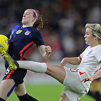 England forward Lauren Hemp (20) tips the ball past the United States midfielder Rose Lavelle (16) during the first match of the 2020 She Believes Cup soccer tournament at Exploria Stadium on 5 March 2020 in Orlando, Florida USA.