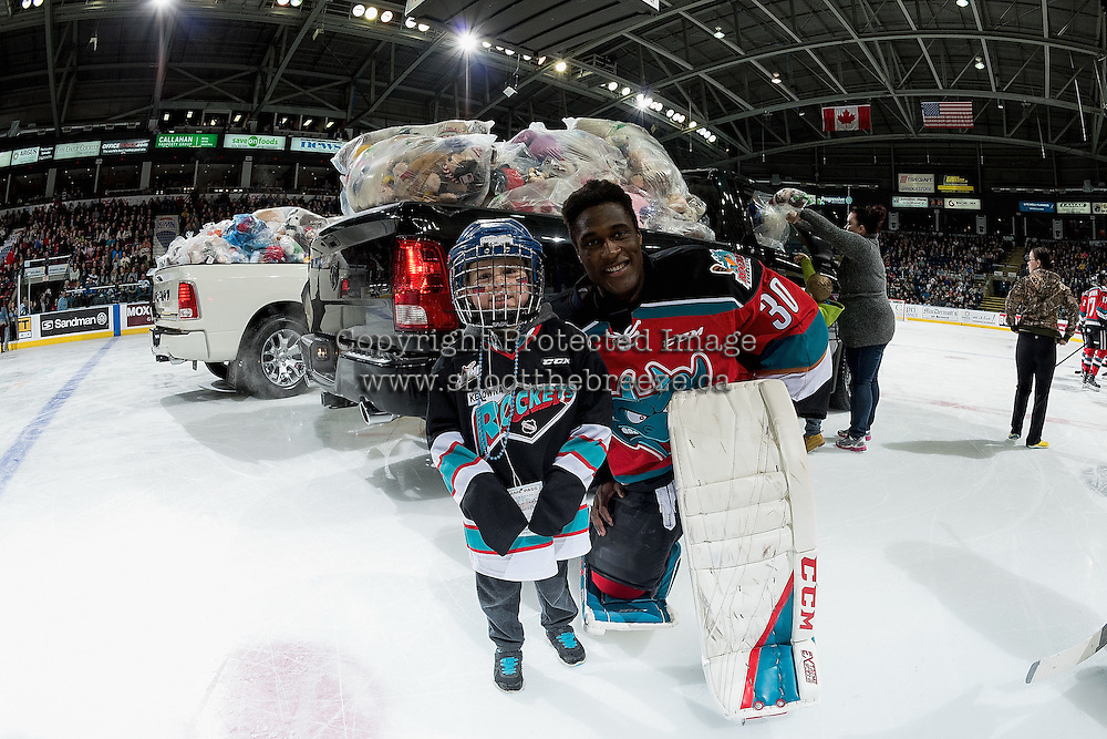 KELOWNA, CANADA - DECEMBER 3: Michael Herringer #30 of the Kelowna Rockets poses on the ice with a young fan during the annual teddy bear toss on December 3, 2016 at Prospera Place in Kelowna, British Columbia, Canada.  (Photo by Marissa Baecker/Shoot the Breeze)  *** Local Caption ***