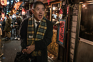 Thick tongue of a drunken salariman.  Omoide Yoko-cho, alleyway of izakaya in Shinjuku.  Tokyo, Japan