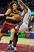 Dec. 2, 2010; Cleveland, OH, USA;  Cleveland Cavaliers power forward Anderson Varejao (17) runs into Miami Heat power forward Chris Bosh (1) during the third quarter at Quicken Loans Arena. The Heat beat the Cavaliers 118-90. Mandatory Credit: Jason Miller-US PRESSWIRE