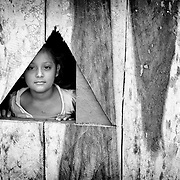 Girl looking out a window. (Nicaragua)