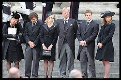 Baroness Thatcher's  family watch her coffin leaving  from the steps of St.Paul's Cathedral in London , Wednesday 17th  April 2013 Photo by: Stephen Lock / i-Images