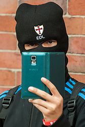 "Rotherham England<br /> 13 September 2014 <br /> EDL supporter films the scenes outside Rotherham Town Hall on his Mobile Phone before the start of the English Defence Leagues Justice for the Rotherham 1400 March on Saturday Afternoon described by an EDL Facebook Page as ""a protest against the Pakistani Muslim grooming gangs"" on Saturday Afternoon <br /> <br /> <br /> Image © Paul David Drabble <br /> www.pauldaviddrabble.co.uk"