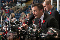 KELOWNA, CANADA - NOVEMBER 6: Dan Lambert, coach of the Kelowna Rockets discusses a call with a referee on NOVEMBER 6, 2013 at Prospera Place in Kelowna, British Columbia, Canada.   (Photo by Marissa Baecker/Shoot the Breeze)  ***  Local Caption  ***