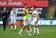 Goalscorer Courtney Baker-Richardson (46) of Swansea City celebrates with Tom Carroll (14) of Swansea City at full time after Swansea beat QPR 3-0 during the EFL Sky Bet Championship match between Swansea City and Queens Park Rangers at the Liberty Stadium, Swansea, Wales on 29 September 2018.