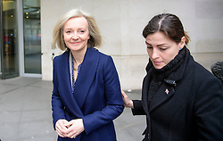 © Licensed to London News Pictures. 19/02/2017. London, UK. Secretary of State for Justice, Lord Chancellor LIZZ TRUSS (left) is ushered by security as she leaves BBC Broadcasting House in London after an appearance on The Andrew Marr Show on BBC one on February 19, 2017. Photo credit: Ben Cawthra/LNP