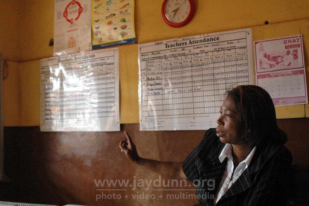 Ghana, Accra, Kokomlemle, 2007. Peace Agbezuge, the headmaster of Kwameh Nkrumah Memorial School, discusses the school's challenges.