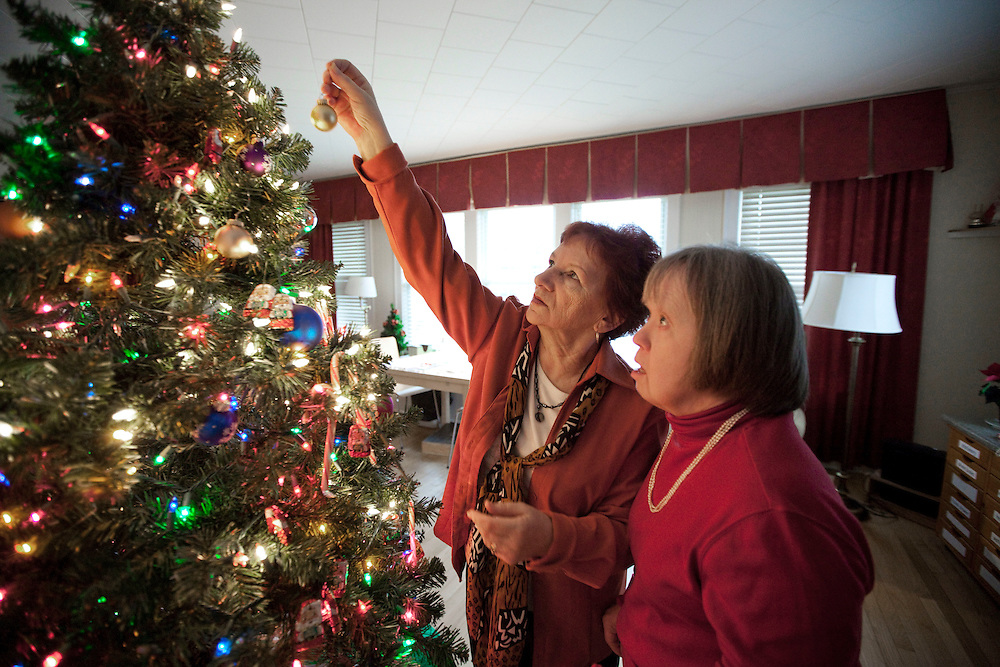 Marybeth Solinski decorates her Christmas tree with help from her caretaker Celina Zabawa one week before Christmas...Aging adults with Down Syndrome. In 1983, people with Down syndrome could expect to live to age 25. Today, their life expectancy is 60 years. We interview a 59-year-old patient who has outlived her parents and is now in AARP. She has trouble walking, but has lots of interests, such as cooking, arts and crafts and reading..