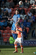 Brad Walker (Hartlepool United) rises above Mark Cullen (Blackpool) to win the header during the EFL Sky Bet League 2 match between Blackpool and Hartlepool United at Bloomfield Road, Blackpool, England on 25 March 2017. Photo by Mark P Doherty.