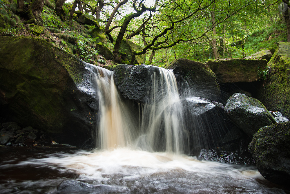 Waterfall in late summer in Padley Gorge, Peak District. Taken with a long exposure and a low angle.
